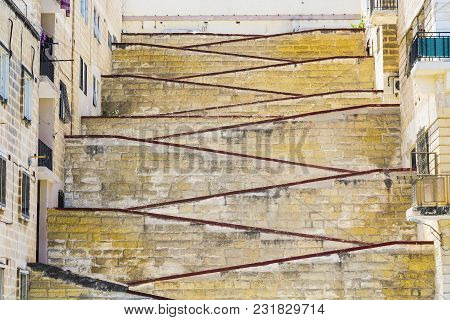 Street With Stairs On The Island Of Malta.