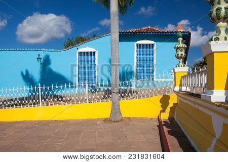 Typical Colonial Building With Window Wooden Grate In Trinidad, Cuba. One Of Unescos World Heritage