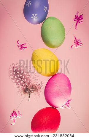 Row Of Flying Colored Easter Eggs On Pink Background, Retro Toned