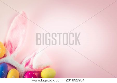 Easter Rabbit Ears And Colored Easter Colored Eggs On Pink Background With Copy Space, Retro Toned