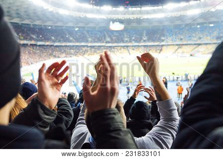 Fans At The Stadium Support The Cotton Sports Club