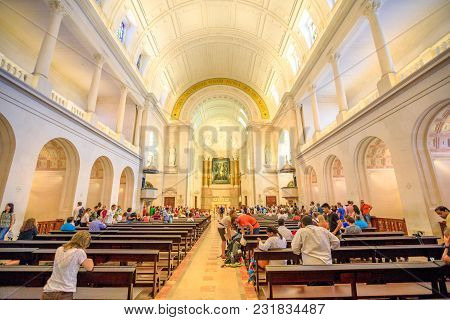 Fatima, Portugal - August 15, 2017: Tourists And Pilgrims Pray Inside The Basilica Of Our Lady Of Fa