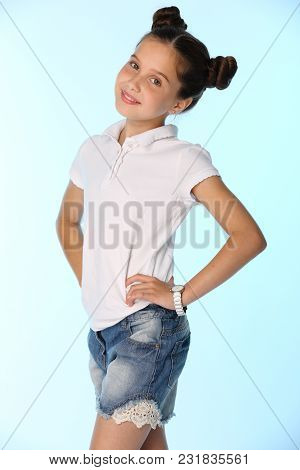 Portrait Of A Charming Pretty Stylish Young Teenage Girl. Beautiful Brunette Child Is Smiling And Lo
