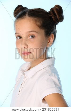 Close-up Portrait Of A Pretty Stylish Young Teenage Schoolgirl. Beautiful Brunette Child Looks Serio