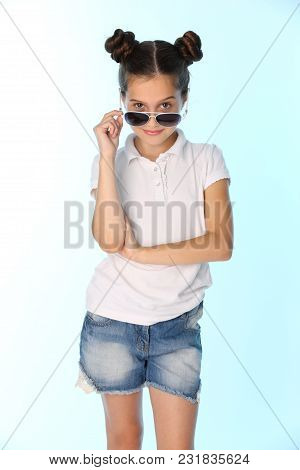 Portrait Of A Charming Pretty Stylish Young Teenage Girl. Beautiful Brunette Child Is Looking Cool W