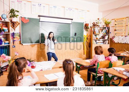 Schoolchildren In The Classroom, Pupils During The Hungarian Lesson Are Sitting At The Desk