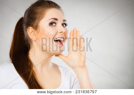 Woman Talking To Someone Gossip And Rumors With Hand Close To Lips.