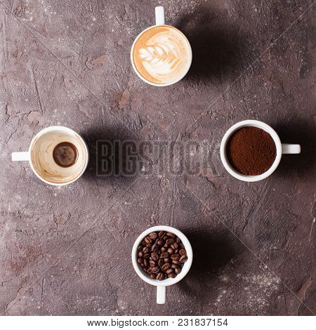 Top View Four Cups Of Different Stages Of Preparing Cappuccino With Copy Space, Shape Of Clock, Time