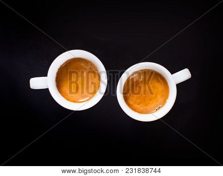 Two White Cups Of Espresso On The Chalkboard Background