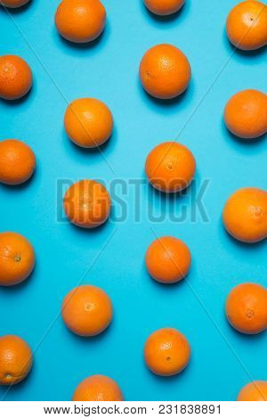 Fresh Oranges On The Blue Background. Top View. Vertical Orientation