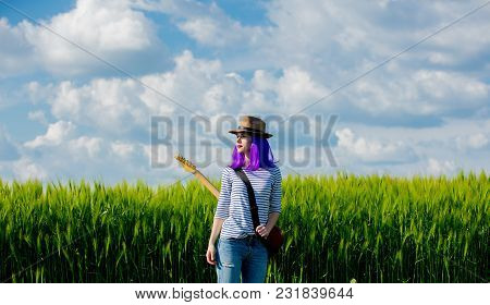 Beautfiul Girl With Guitar At Wheat Field In Summertime Season