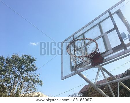 Outdoor Basketball Hoops With Sun And Clouds