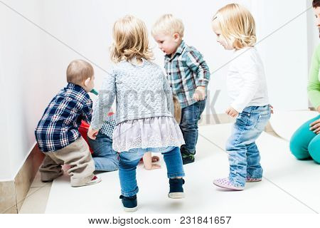 Cute 1-2 Years Old Children Play With Red Packet As Their Home