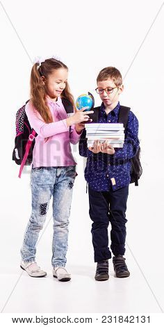 Pupils Boy And Girl Isolated On The White Background. Teenagers With Backpacks Holding Books In The