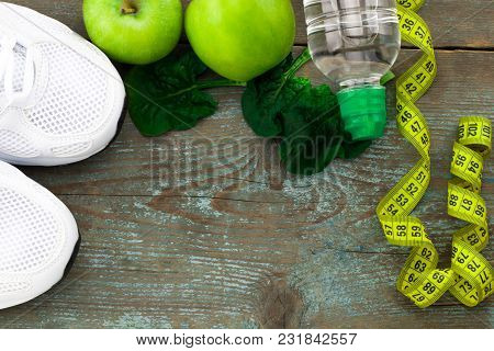 Sport Shoes, Apples, Bottle Of Water On  Wooden Background. Concept Healthy Lifestyle, Healthy Food,