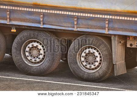Parking trucks wheels close up
