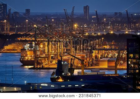 Container ship and cranes in an old dock in Rotterdam Waalhaven