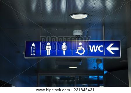 Toilets sign in a building corridor