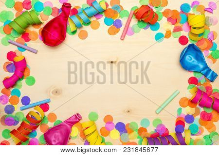 Colorful Confetti And Streamer As Party Decoration Lying On Wooden Background With Blank Copyspace A