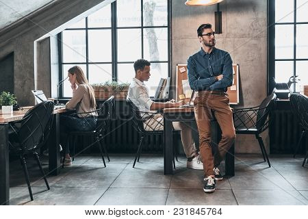 Successful Business Team. Young Modern People In Smart Casual Wear Concentrating At Work While Spend
