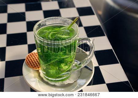 Fresh mint tea served in a glass cup