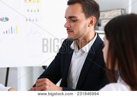 Group Of People Deliberate On White Board Problem In Office Closeup. Graph Consult Idea Participate