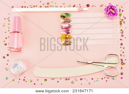 Nail Designs On Tips And Manicure Set On A Pink Background. Photo With Free Space For Text.