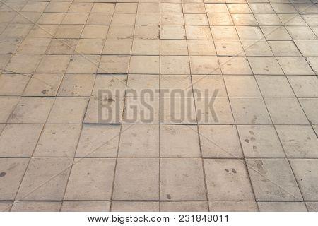 Pattern Of Square Pavement Sidewalk In Evening Sunlight.