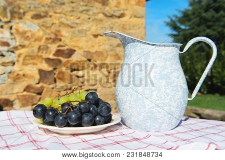 Jar drink and fruit in stillife in the sun