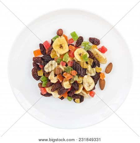 Pile Of Dried Fruits In Plate Isolated On White Background. Top View.