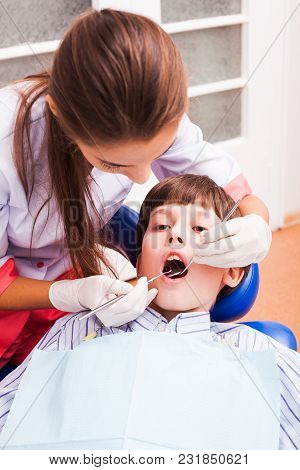 Teenage Boy At The Dental Clinic, Prevention And Treatment Of Dental Caries