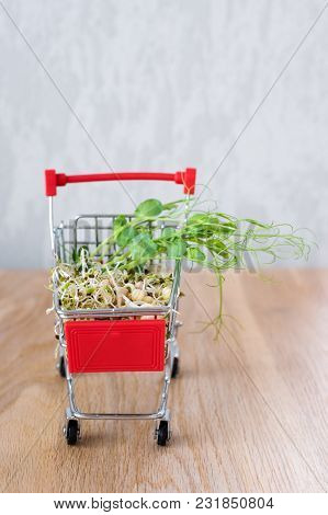 Micro Greens In Shopping Cart On Wooden Background. Different Types Of Microgreens For Sale. Healthy