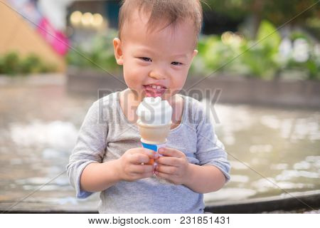 Cute Little Smiling Asian 18 Months / 1 Year Old Toddler Baby Boy Child Sitting At Small Garden In C