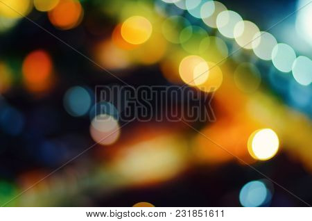 Abstract Defocus Of Colorful Glittering Shine Bulbs Lights Background