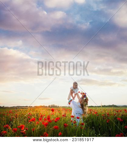 Mom With Her Baby In The Poppy Field, Beutiful Landscape