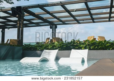 Sunbath Chair In The Pool Ideal For Travel And Vacation Concept