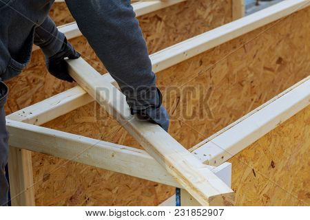 Closeup Of A Carpenter's Hands On A Construction Site. Focus On Drill And Hand.