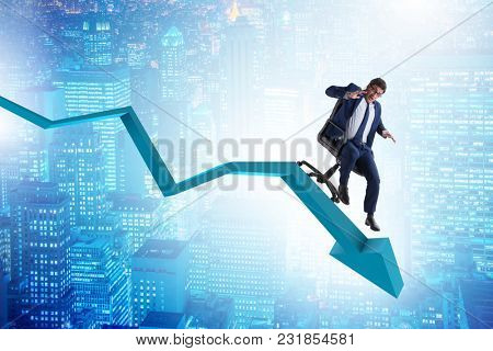 Businessman sliding down on chair in economic crisis concept