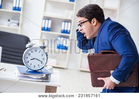 Businessman in bad time management concept