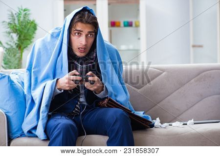 Employee suffering from flue playing computer game at home