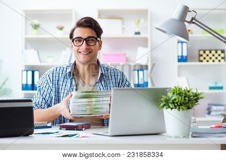 Sales assistant at publishing house showing ready printed books
