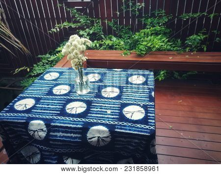 Green Leaves And Table In The Garden. Home Garden Decoration.