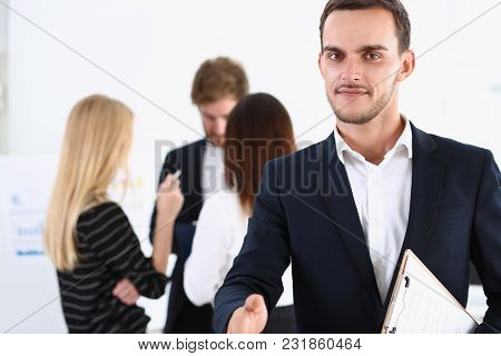 Smiling Handsome Cheerful Man Offer Hand As Hello In Office Portrait. Serious Excellent Prospect, Fr