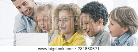 Kids Looking At Laptop Screen