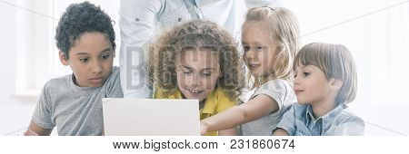 Girl Pointing At Laptop Screen