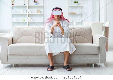 Arab man with virtual reality glasses