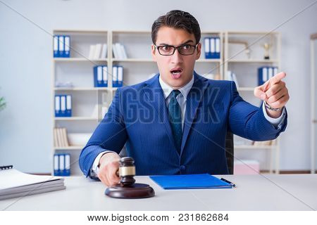 Young lawyer judge sitting in the office