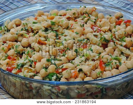 Details Of A Fresh Salad Of Spiced Chickpeas In A Glass Bowl