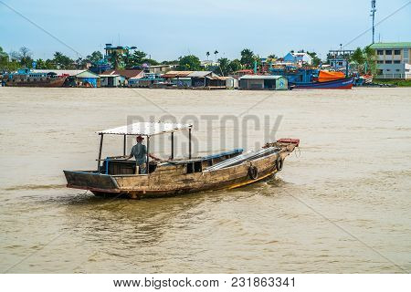 Vietnamese Boat Moving Along Mekong River