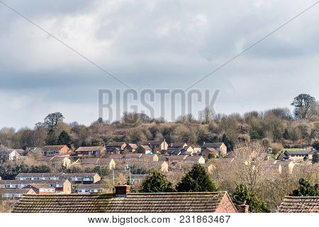 Urban Scene Across Built Up Area Showing The Slate Roof Tops Of Terraced Houses On An Old Housing Es